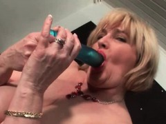 Chesty mature gets fingered...