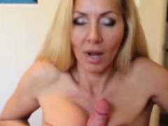 Busty mature tugs till she...