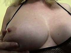 Busty MILF playing with...